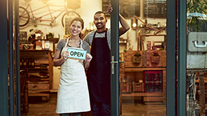 Entrepreneurs with their new business storefront